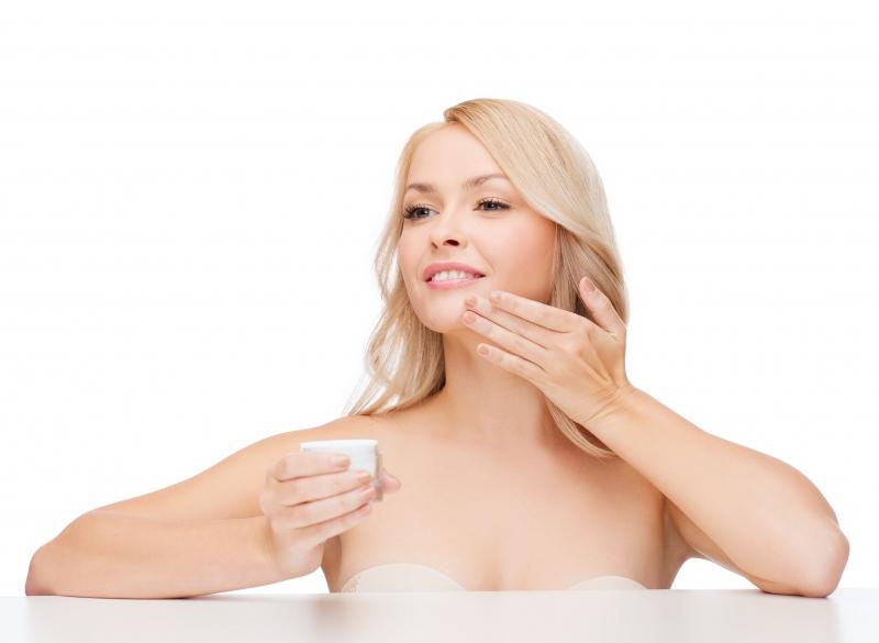 7910035-beautiful-woman-applying-cream-on-her-skin